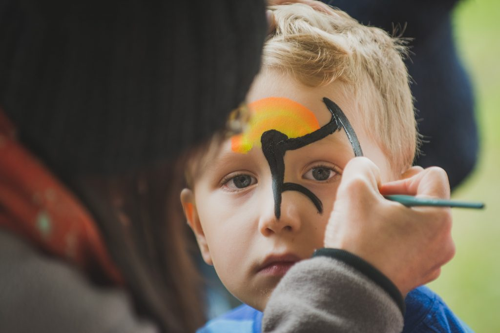 'A' having his face painted